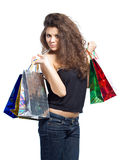 Go shopping. Beautiful young woman holding shopping bags isolated on white Stock Photos