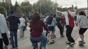 21 June, Moscow, Russia, Go skateboarding day, crowd skaters, young professionals and amateur athlete boy is drive on. Go skateboarding day, crowd skaters, young stock video footage