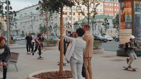 21 June, Moscow, Russia, Go skateboarding day, crowd skaters, young professionals and amateur athlete boy is drive on. Go skateboarding day, crowd skaters, young stock video