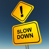 Go slow. Slow down words on a roadsign, against a blue sky, concept Stock Photos
