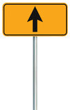 Go straight ahead route road sign, yellow isolated roadside traffic signage, this way only direction pointer, black arrow frame. Roadsign, grey pole post Stock Photography