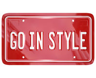 Go In Style Vanity License Plate Car Automobile Vehicle. A red vanity license plate for a car or other vehicle with the words Go in Style to illustrate Stock Photo