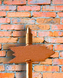 Go There. Handmade Wooden Signpost Over Brick Wall Royalty Free Stock Image