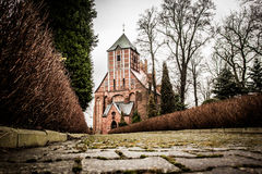 Old medieval church. Corridor to the XIII century old church in small town in Poland Stock Photos
