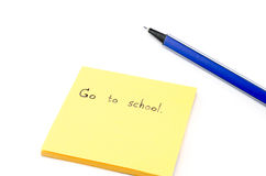 Go to school word on orange post it with blue pen isolated on wh Royalty Free Stock Image