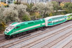 Go Transit train in Toronto, Canada. Toronto, Canada - Oct 11, 2017: Go Transit train leaving the city of Toronto. Province of Ontario, Canada Stock Photos