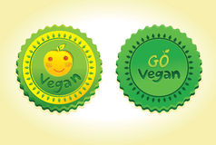 Go vegan badge. Illustration in 2 different versions Royalty Free Stock Images