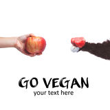 Go vegan! Concept of veganism. Vegan diet. Human hand with apple Stock Photos