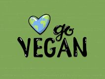 Go vegan lettering on a green background, near a planet earth in the form of a heart . Eco friendly conceptual handwritten phrase. vector illustration