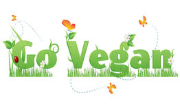 Go Vegan text. Go Vegan text decorated with flowers,grass,water drops, ladybug  and butterflies Stock Images