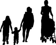Go for walk. Silhouette of mother with baby buggy and kids Stock Image