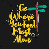 Go where you feel most alive. Premium motivational quote. Typography quote. Vector quote with black background stock illustration