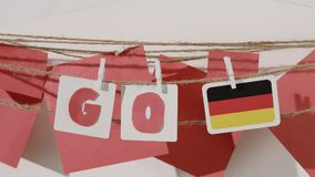 Go word collected by child hand from paper cards stock video footage
