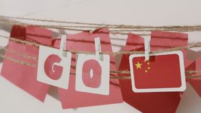 Go word collected by child hand from paper cards stock video