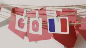 Go word collected by child hand from paper cards stock footage