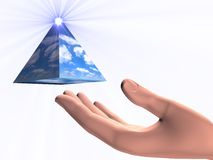 Go for your dream. A shiny pyramid floating over a human hand Royalty Free Stock Photography