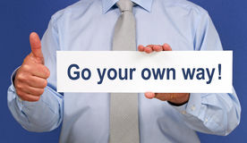 Go your own way - Businessman with thumb up stock photos