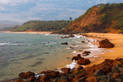 Goa beach. Cola beach in Goa with rocks and sand stock images
