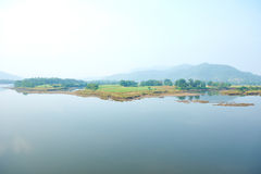 Goa. Calm water of lake, woods on other side and blue sky. The beauty of India. Goa Royalty Free Stock Images
