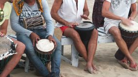 Unidentified man playing on drum at the beach. Goa, India – February 28, 2015: Unidentified man playing on drum at the beach stock video
