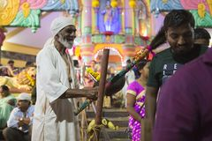 GOA, India – Oct, 2017: Indian Baba blessing people at the fea. GOA, India – Oct, 2017: Indian Baba blessing people at the feast. Sadhu near the temple Stock Photo
