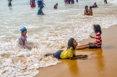 GOA, INDIA, Asia. MAY 2017: Selective Focus: Image of Young Asian preschool boy and girl, brother and sister, playing with water o stock photos