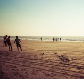 Goa, India - December 20, 2018: Fishermen fishing with nets on Morjim Beach.  stock image