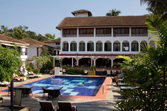 Goa, India - December 16, 2016: Swimming pool area of a hotel in Baga, Goa.  Stock Images