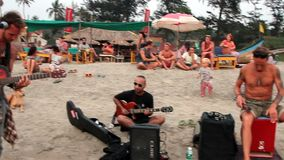 Unidentified man playing music on the beach. Goa, India - February 27, 2016: Unidentified man playing music on the beach stock footage