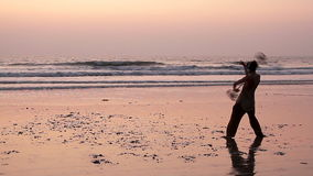 Unidentified man spinning pole on the beach. Goa, India - February 10, 2016: Unidentified man spinning pole on the beach stock video