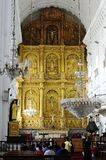 Golden panelling in Goa, India. Goa, India - January 2017:congregation in The S� Catedral de Santa Catarina Royalty Free Stock Images
