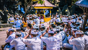 GOA LAWAH, BALI, INDONESIA - November 3, 2016: Balinese praying on ceremony at Pura Goa Lawah temple, Bali, Indonesia Royalty Free Stock Images