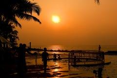 Goa Sunset. Sun setting over pool and ocean Goa India royalty free stock photo