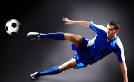Goal. Image of soccer player doing flying kick with ball Stock Photography
