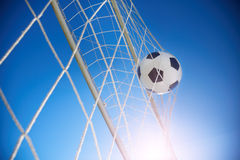 Goal. Soccer ball going into goal net ,selective focus Stock Images