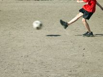 Goal. Legs of boy playing football Stock Image