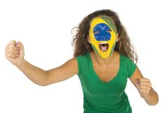 Goal!. Young screaming Brazilian sport's fan with painted flag on face and with clenched fist. Front view. Looking at camera, white background Stock Image