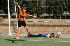 Goal. Children playing football  scoring goal soccer Stock Images