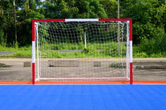 Goal of blue soccer field. Red and white goal of blue and orange soccer field Stock Images