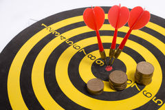 The goal of business is intended to accomplish as a team darts on white background with arrows, middle target Stock Photo