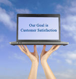Goal is customer satisfaction. Our goal is customer satisfaction Stock Image
