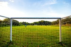 Goal football in the park with a sun light. royalty free illustration