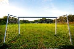 Goal football in the park with a sun light. Goal football on grass in the park with a sun light stock photos