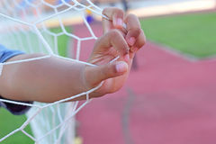 Goal football - soccer nets in hand Stock Photography