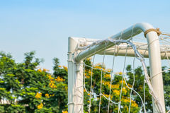 Goal of football or soccer type sport. Goal corner of football or soccer with net sky and trees Royalty Free Stock Photography