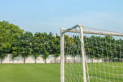 Goal of football or soccer type sport. Goal corner of football or soccer with football pitch Stock Image