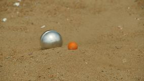 Goal in the game petanque. Goal in the game of petanque, slow motion stock video