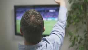 Goal!. Man watching football match on television at home stock video