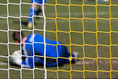 Goal and goalkeeper in soccer net Stock Image