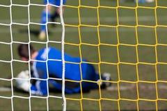 Goal and goalkeeper in soccer net stock image